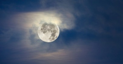 Full moon and cloudy sky