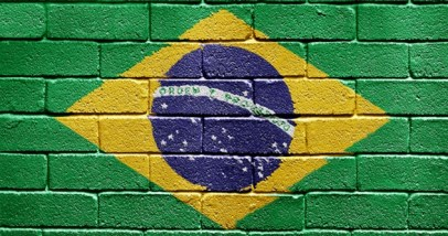 Flag of Brazil on brick wall