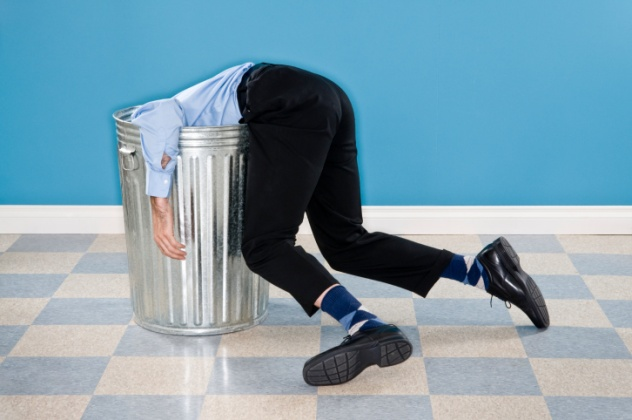 Man in Trash Can