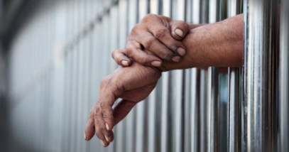feature-a-hands-prisoner_000089959949_Small