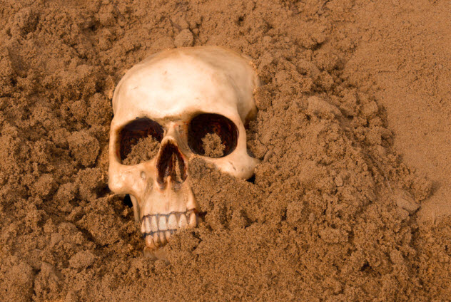 7b-skull-buried-man_24949542_SMALL