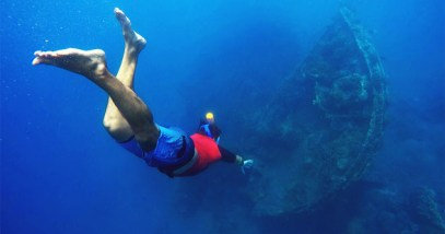 Diving to the shipwrecks, snorkeler in the deep blue sea