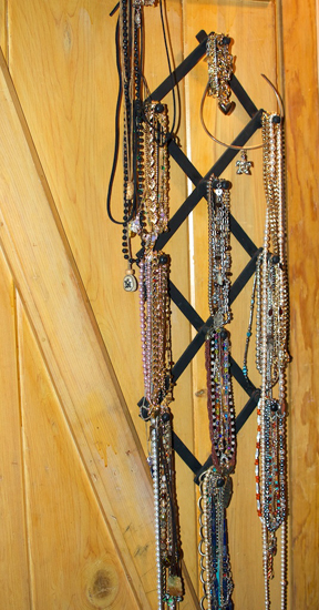 necklaces hanging on a rack inside my closet door
