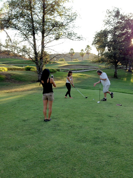 Nia getting some swing tips from our host Ron
