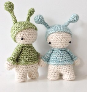 two crocheted elfs