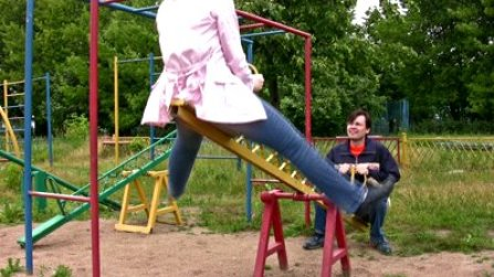 stock-footage-couple-on-seesaw