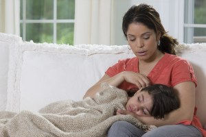 Hispanic-Mother-with-Sick-Child