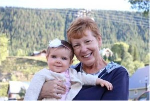 Becca with her first grandchild, Nora