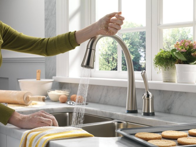 vintage single lever kitchen faucet on grey tempered ceramic counter top and a couple of metal washbasin