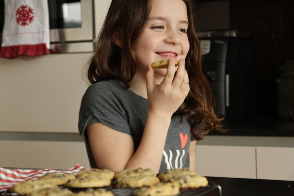 Girl smiling with Chocolate Chip Cookie