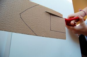 Cut along the lines you drew for your rubber band powered boat