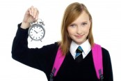 school girl with alarm clock 300x200