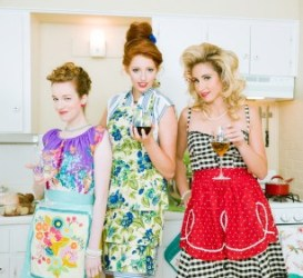 Creative hair and bright red lipstick pair well with bold patterns in these 1950s housewife looks. Photo by iStock.