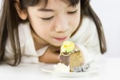 little girl and cake 300x200