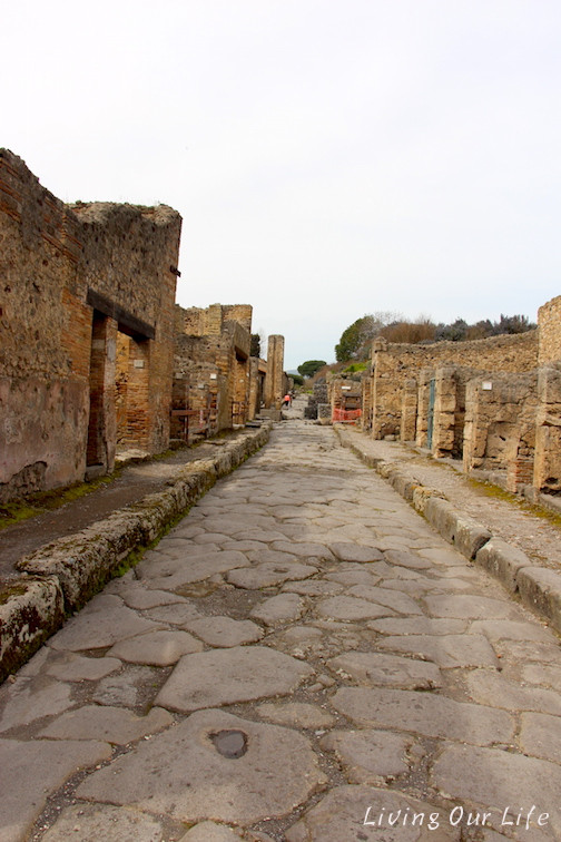 Streets of Pompeii showing sidewalks and shops and homes