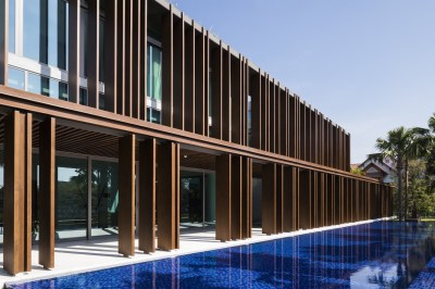 The Louvers House in Vietnam by MIA Design Studio features a unique facade and lush central ...