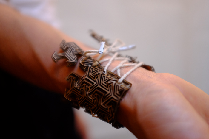 The back of the bracelets laces up with twine.