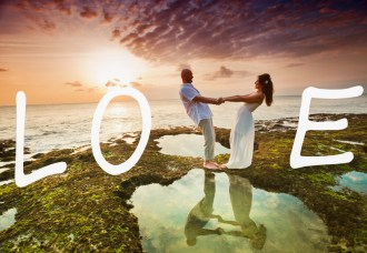 wedding couple just married at Hawaii near the beach with love text