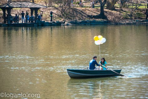 Couple on boat on lake with balloons