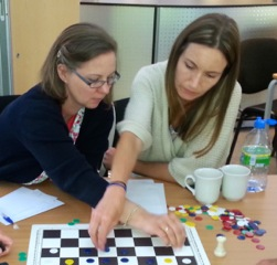 Photo of two ladies working with a chessboard