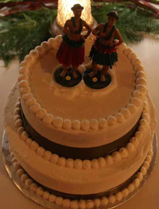 Two male hula dancers on the cake