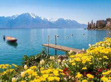 Flowers, mountains and jetty on Lake Geneva, Montreux, Switzerland