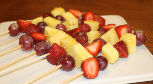 Assemble the fruit skewers.