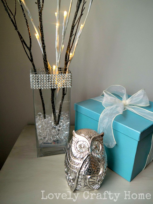 bling vase with lighted twigs