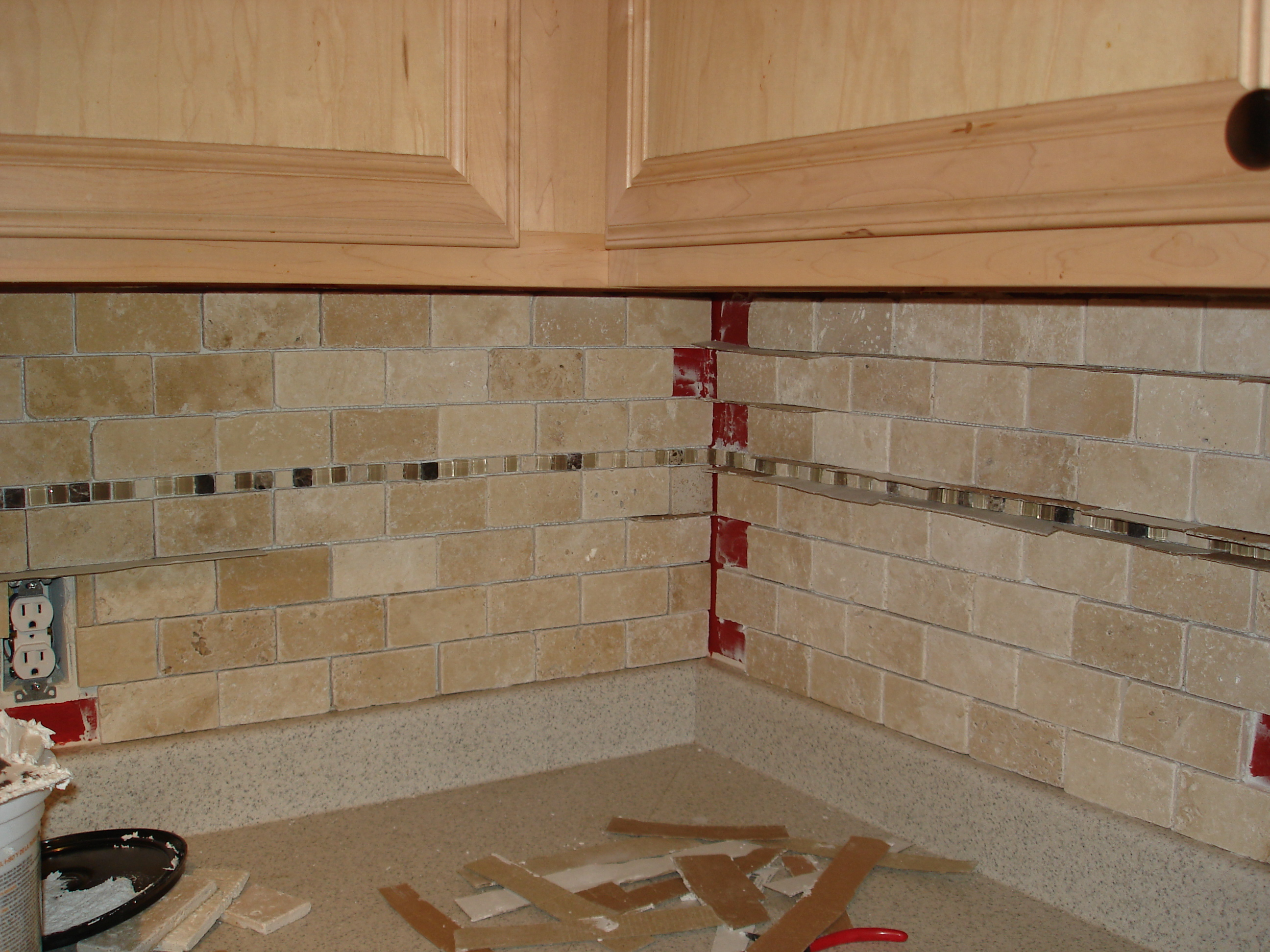 Tutorial tile kitchen back splash when you come upon an outlet youll need to make sure that you tile close enough to the outlet box so that the cover has good support but whatever you do dailygadgetfo Choice Image