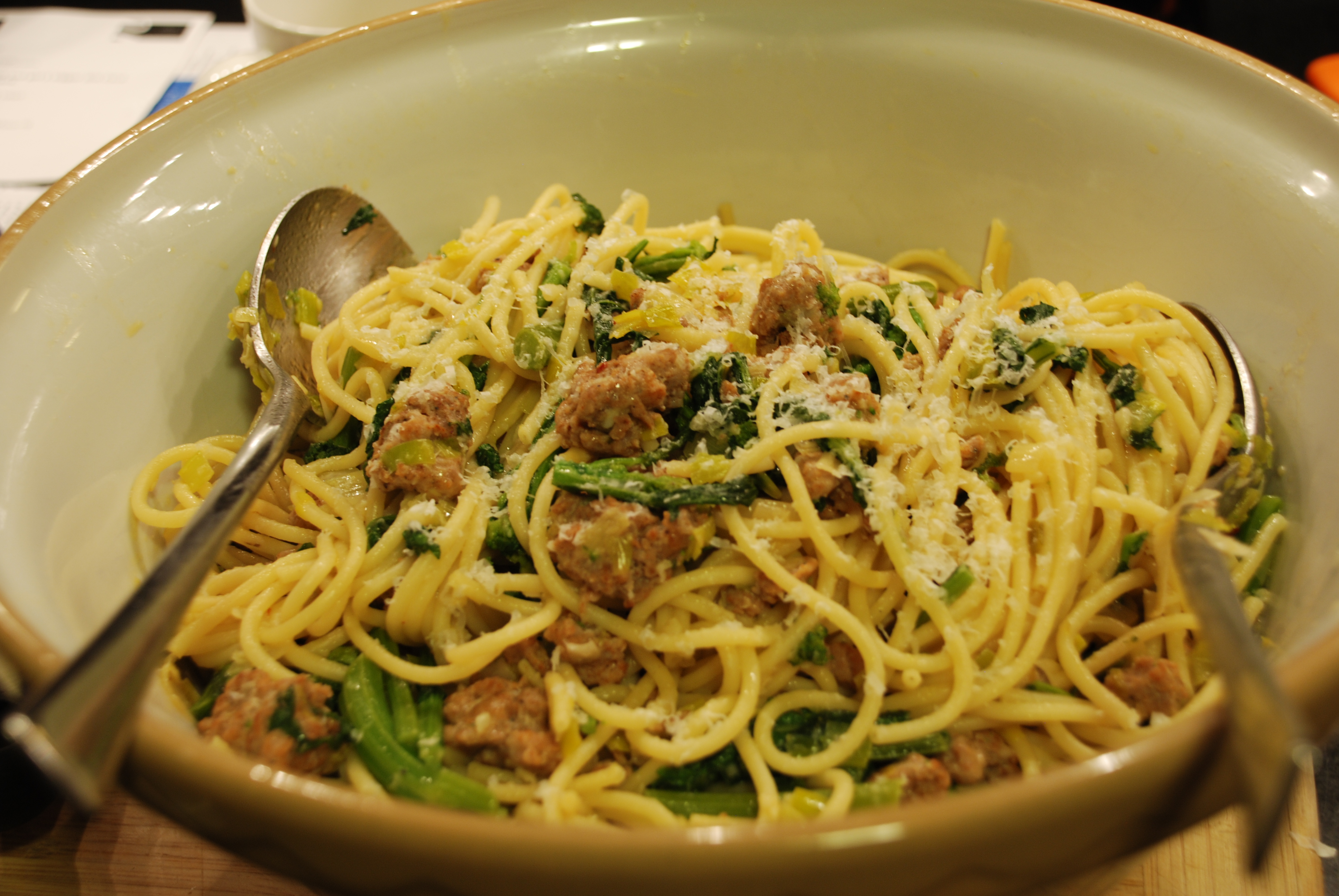 Pasta with broccoli rabe and chicken sausage in a bowl.