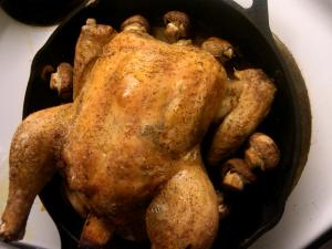 Roast chicken in pan.