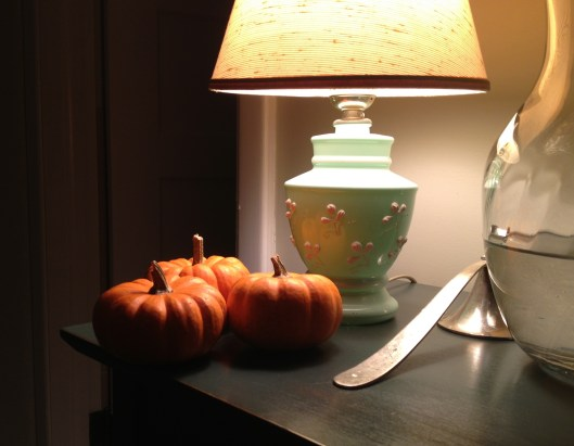 Three pumpkins at nightime - the end of Thanksgiving.