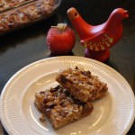 christmas cookies that are Hello Dolly squares with coconut, chocolate and pecans