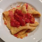 Mark Bittman's homemade handkerchief pasta with plum tomato red sauce in a bowl, topped with parmesan cheese