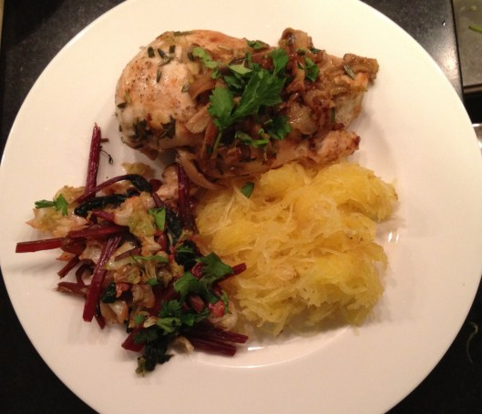Spaghetti squash with sauteed chicken and beet greens.