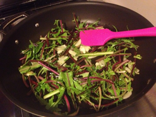 Get It Right spatula in a pan of red stemmed, organic dandelion greens with garlic.