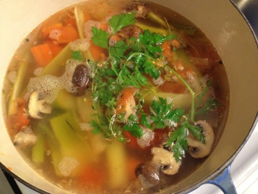 Vegetable stock in a Le Creuset Dutch oven.
