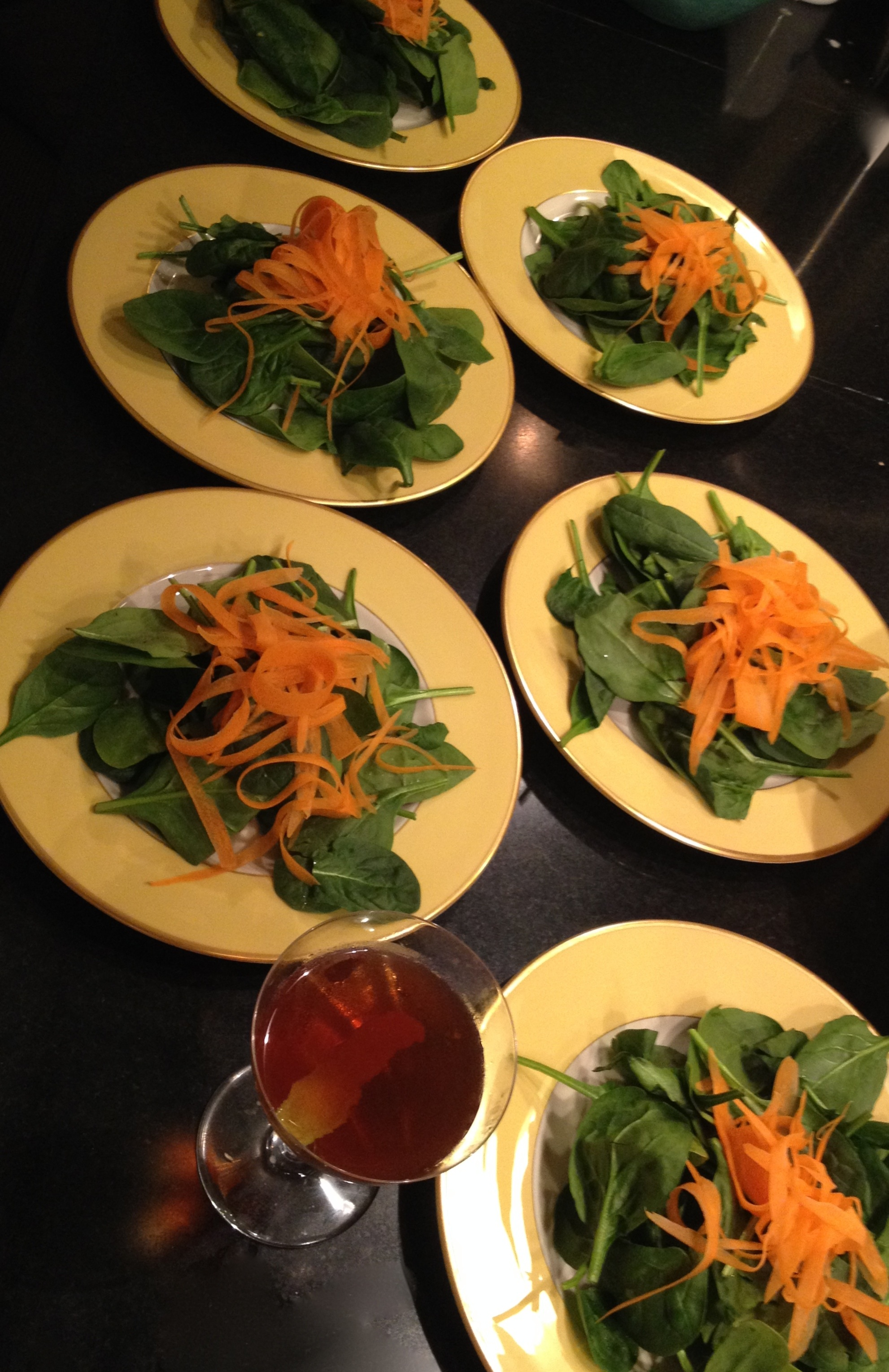 Baby spinach salad with carrots and ginger miso dressing.