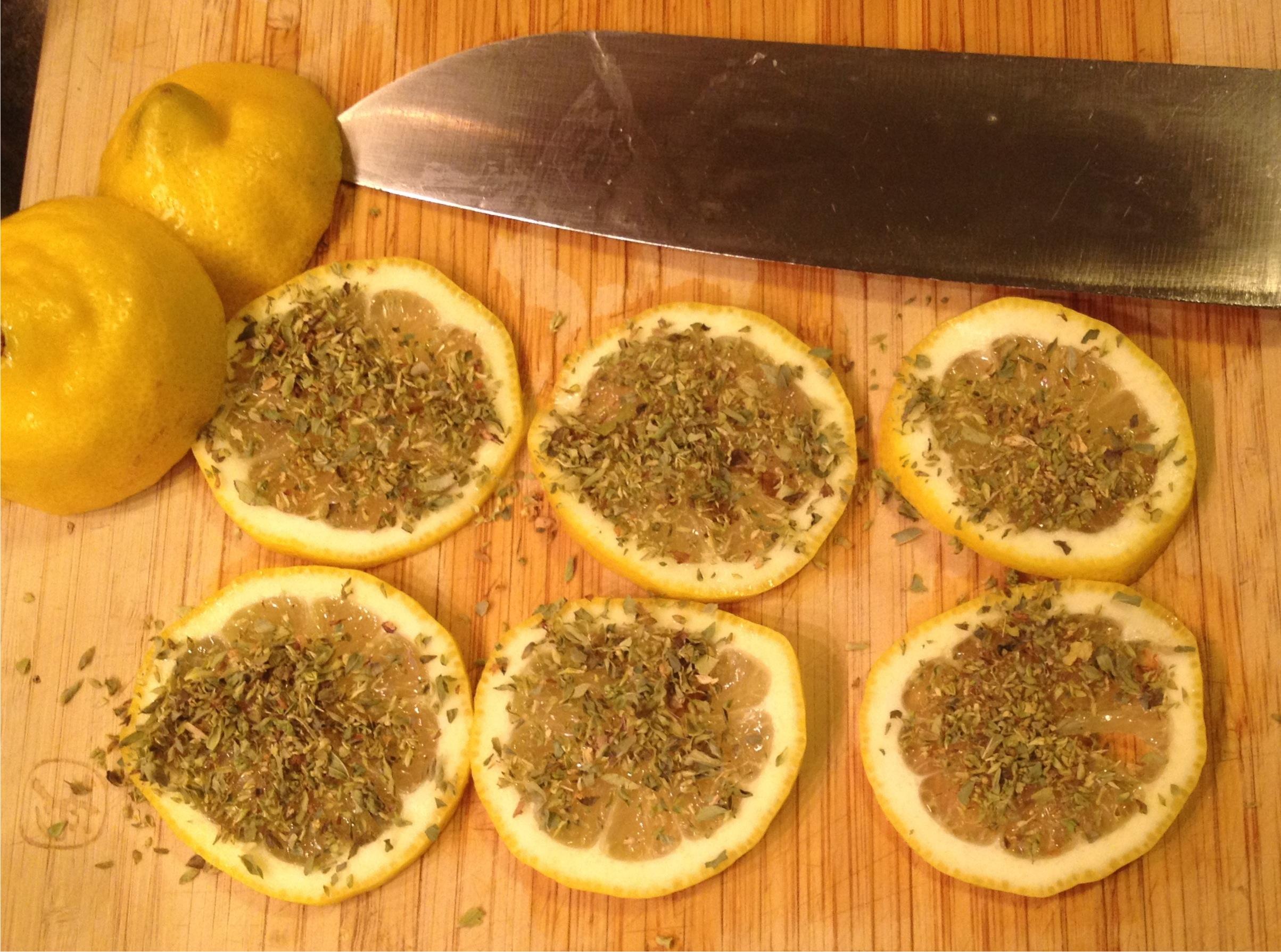 lemon slices covered with Greek oregano
