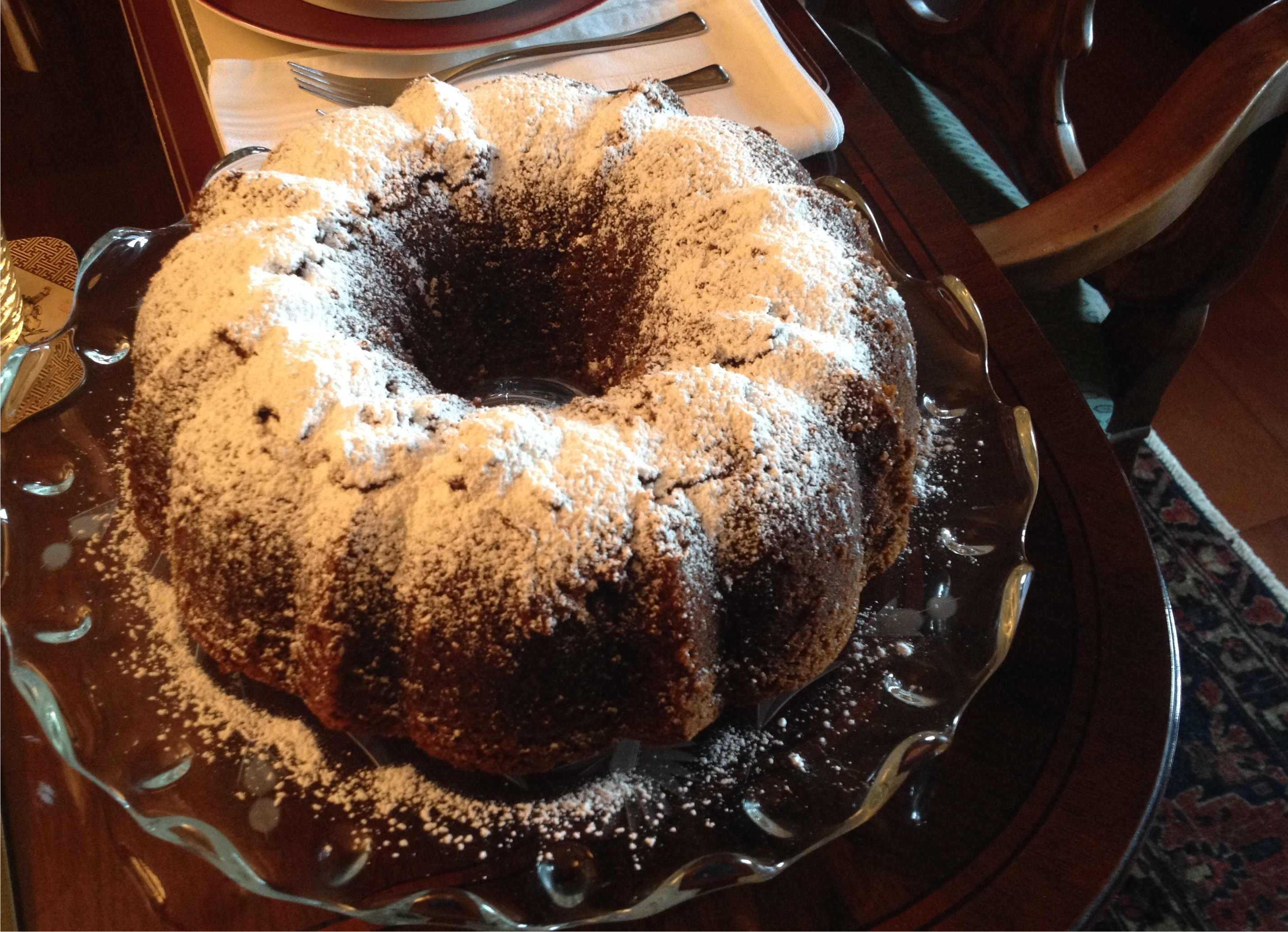 Bruce cost ginger ale spice cake on a crystal platter.