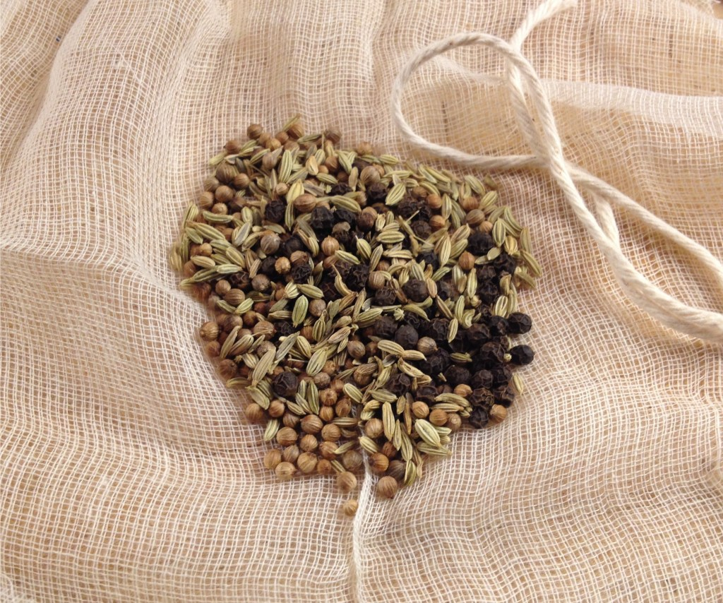 Fennel, coriander and peppercorns on cheesecloth ready to be bundled and tied.