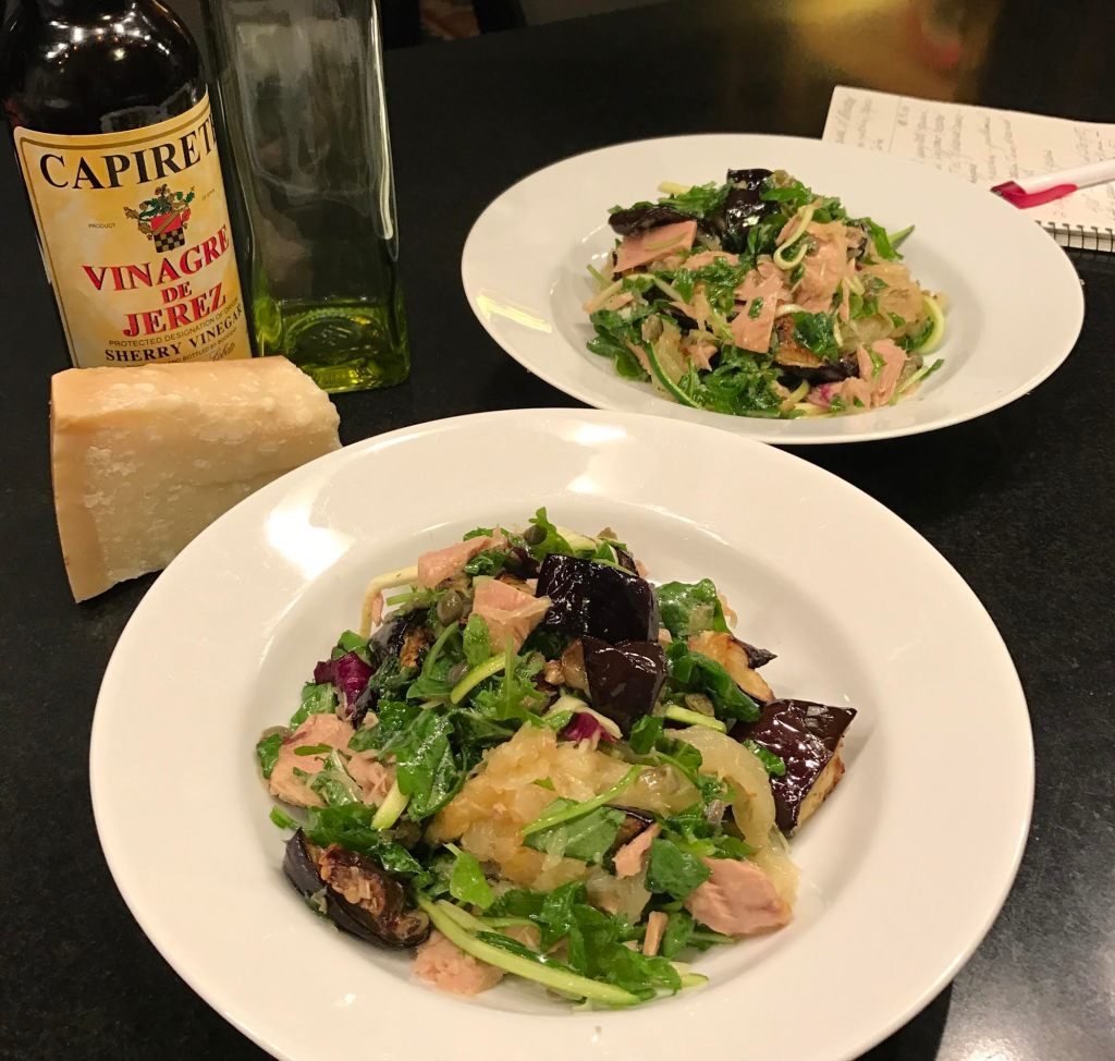 Spaghetti squash with roasted eggplant, fresh zucchini, capers, and Italian Tuna - finished dish in white soup bowls.