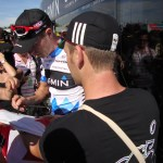 Ryder Hesjedal signing l'Unifolié. It's a very long story as to why I had a Maple Leaf flag with me... save that for another time