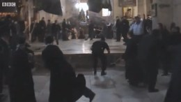 Broomstick-hurling at a holy place (image: still from a BBC video clip)