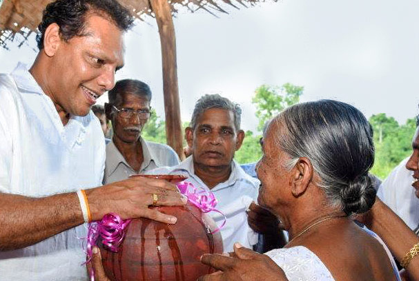 Governor offering safe drinking water to an old lady - Sri Lanka