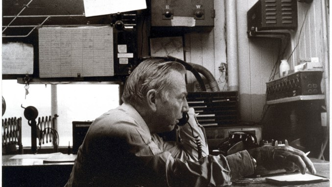 L. Stanley Crane, chairman and CEO of Conrail, calls in to his Philadelphia office from a switching tower near Youngstown, OH, about 1984. Photo Copyright ©Steven L. Lubetkin. All rights reserved.