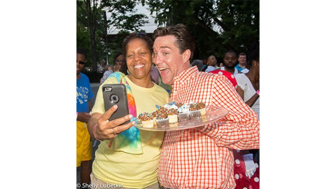 KYW-TV Consumer Reporter Jim Donovan, right, poses for a selfie during Kencrest Services' family reunion event at the Philadelphia Zoo. (Shelly Lubetkin Photo for Kencrest Services.)
