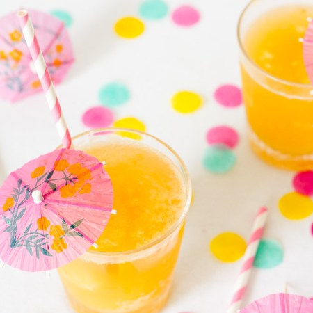A mixture of pineapple, banana, and orange is frozen, cut into ice cubes, and topped with your favorite fizzy drink in this family-friendly, retro Tropical Party Slush.