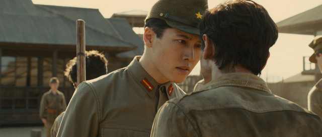 """Universal Pictures The Bird (Miyavi) torments Louis """"Louie"""" Zamperini (Jack O'Connell)."""