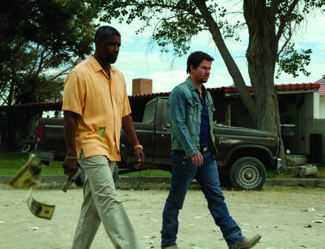 """(L to R) Academy Award® winner DENZEL WASHINGTON and MARK WAHLBERG lead an all-star cast in """"2 Guns"""", an explosive action film that tracks two operatives from competing bureaus who are forced on the run together. But there is a big problem with their unique alliance: Neither knows that the other is an undercover federal agent."""